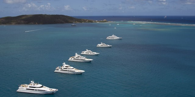 The Westport Rendezvous Cruise in Company motor yachts pose for their photoshoot in front of Mosquito Island